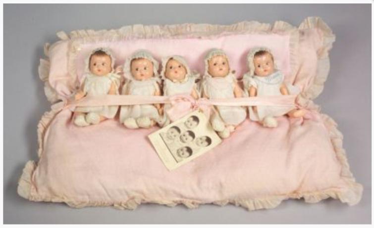 Mme Alexander Dionne Quintuplet Babies on original pillow bed